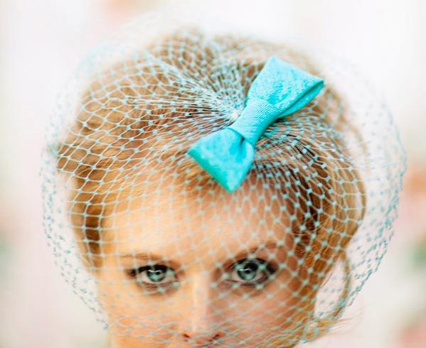 http://www.lucydylanweddings.com/wp-content/uploads/2010/06/blue-birdcage-veil-vintage-.jpg
